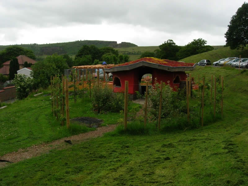 The eco-play shelter with sedum roof and small award winning permaculture garden.